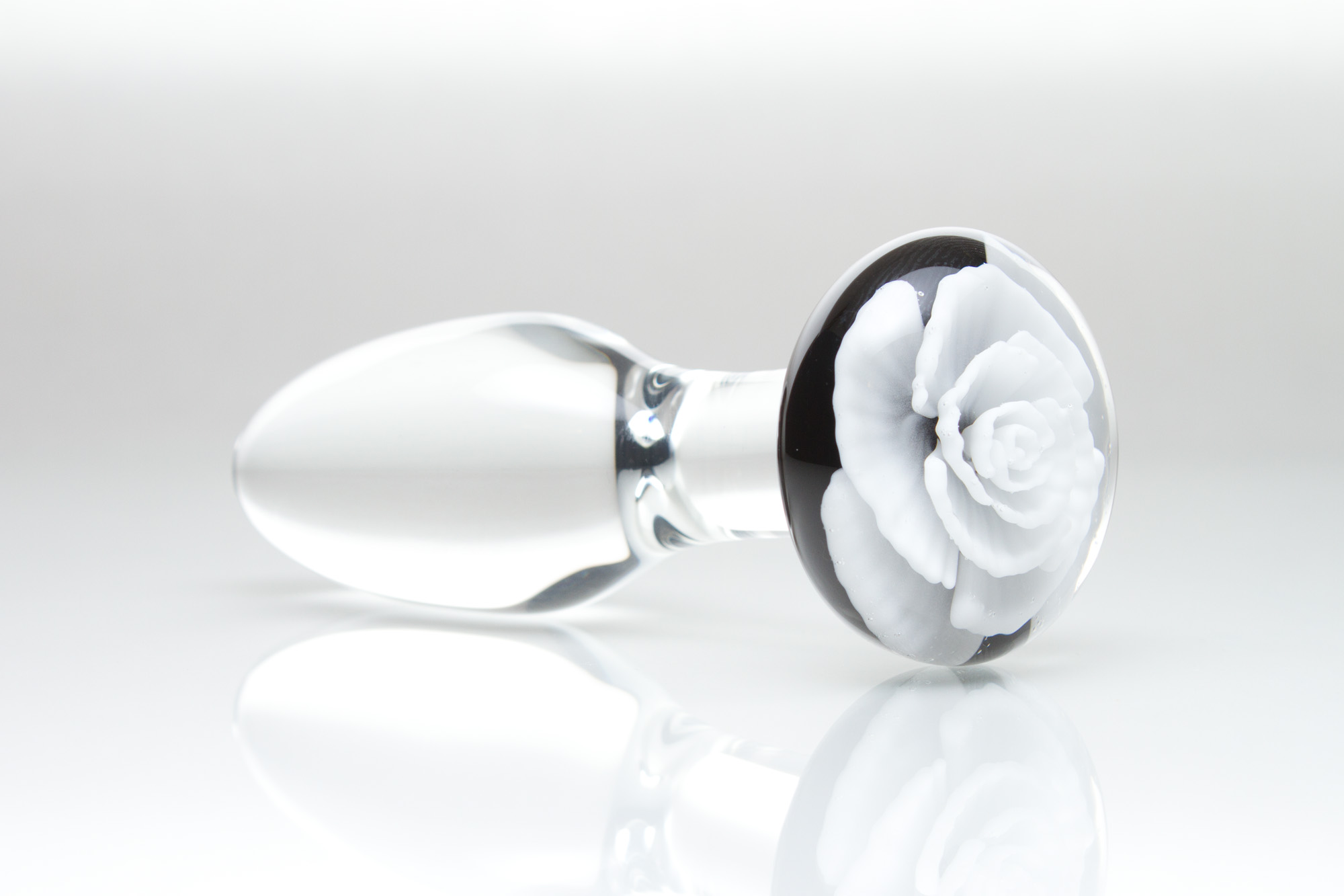 three Quarter View white rose glass butt plug by Hedonic Glass